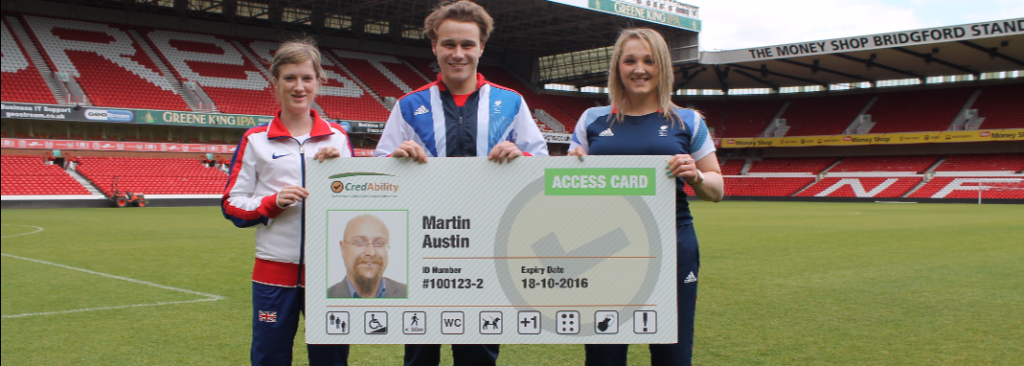 paralympians holding a mock up of the Access Card