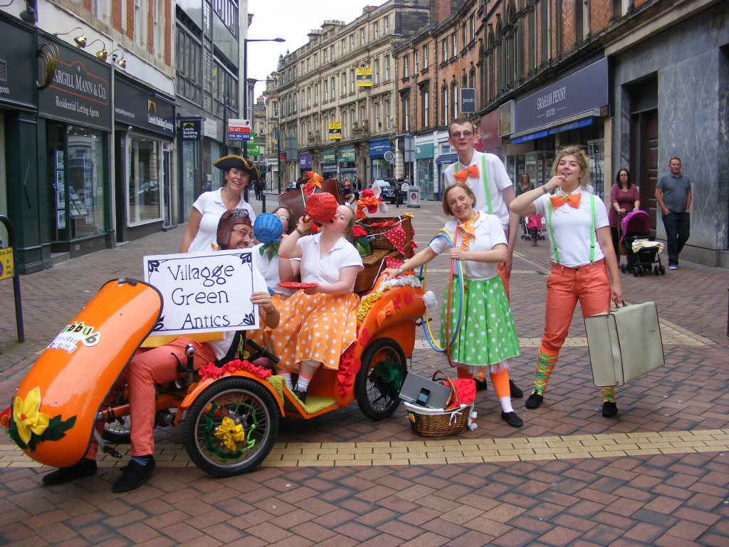 photo of people in fancy dress and orange buggy
