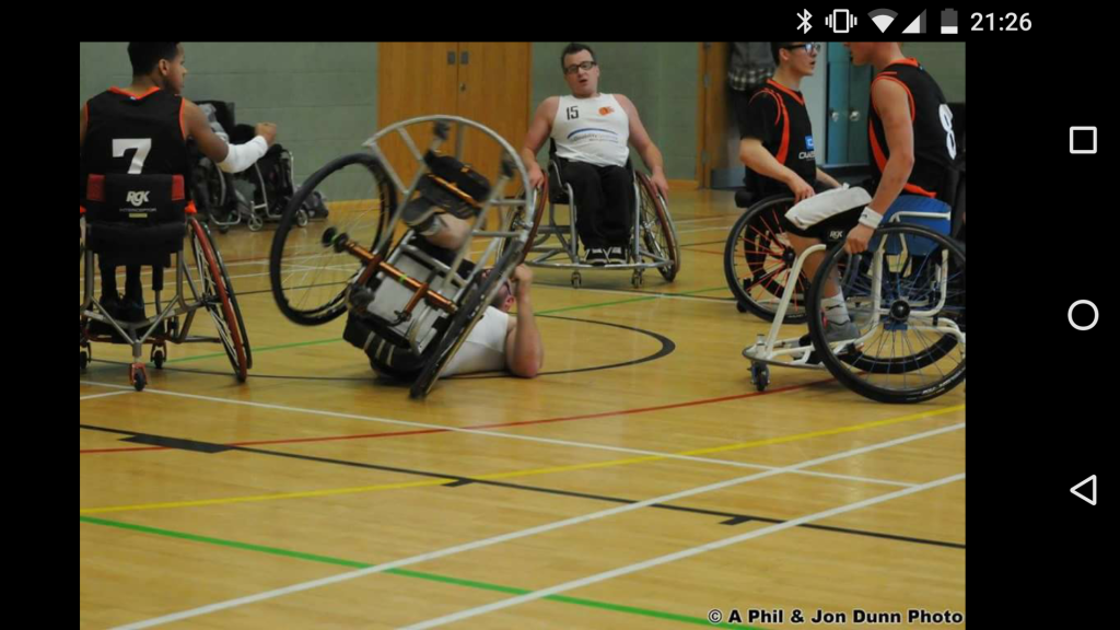 wheelchair basketball photo of player falling.