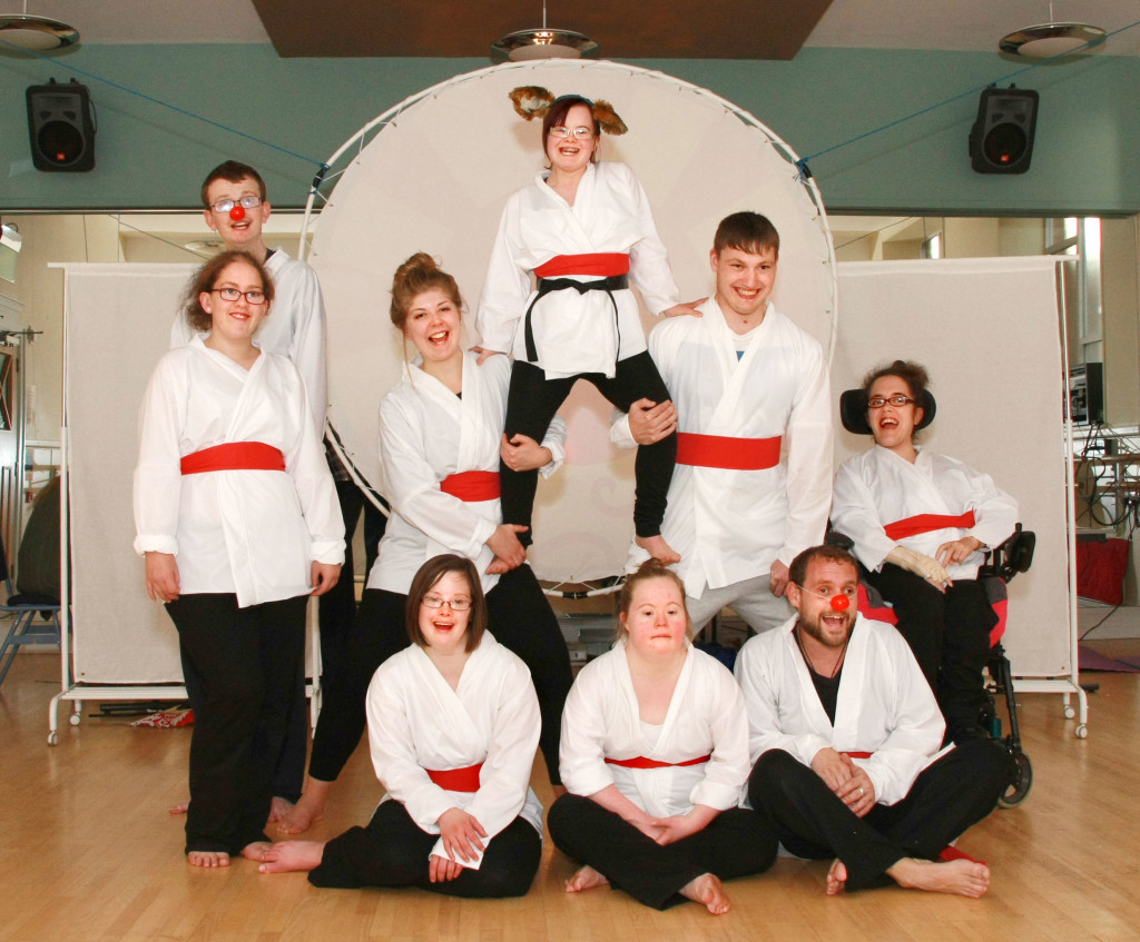 photo of disabled people with karate gi.