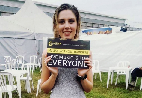 Girl next to marquee with Access if everything small banner