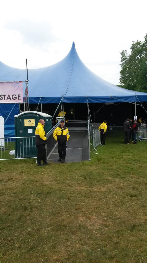 photograph of tent stage and security next to accessible viewing platform ramp