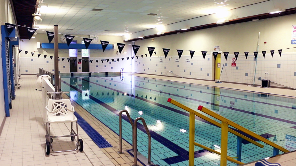 photo of interior swimming pool and accessible pool chair at venue