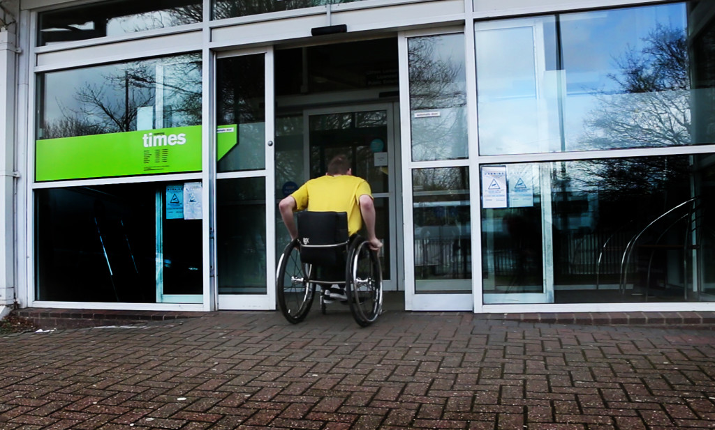 Photo of wheelchair user at entrance