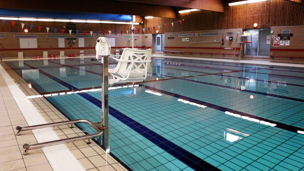 interior pool photo with chair hoist