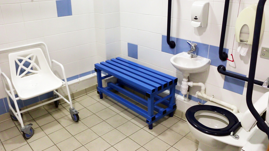 photo of accessible toilet area with blue bench