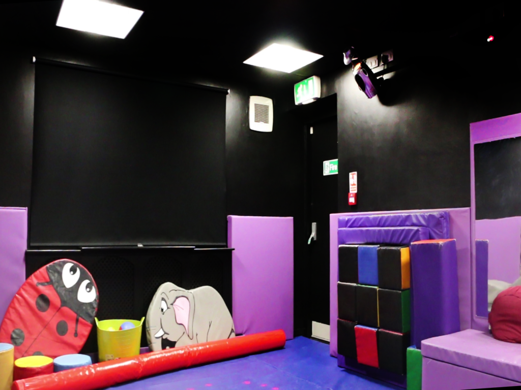 interior sensory room with dark walls and foam toys