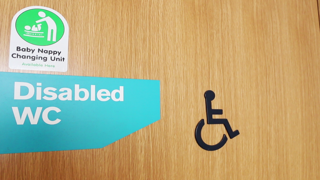 photo of accessible toilet door with signage