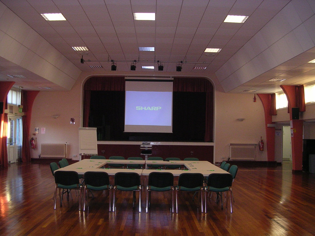 interior photo of tables chairs and projector setup