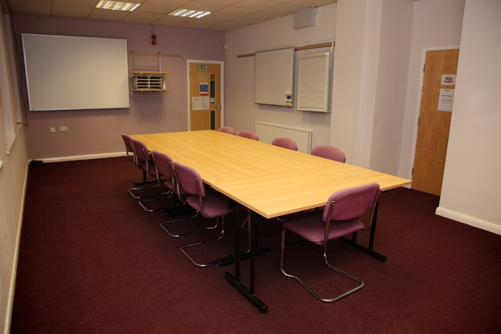 interior photo of meeting room and table and chairs