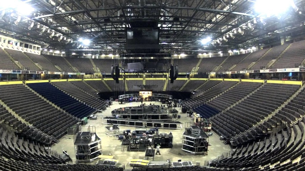 interior photo of seating in arena and stage setup