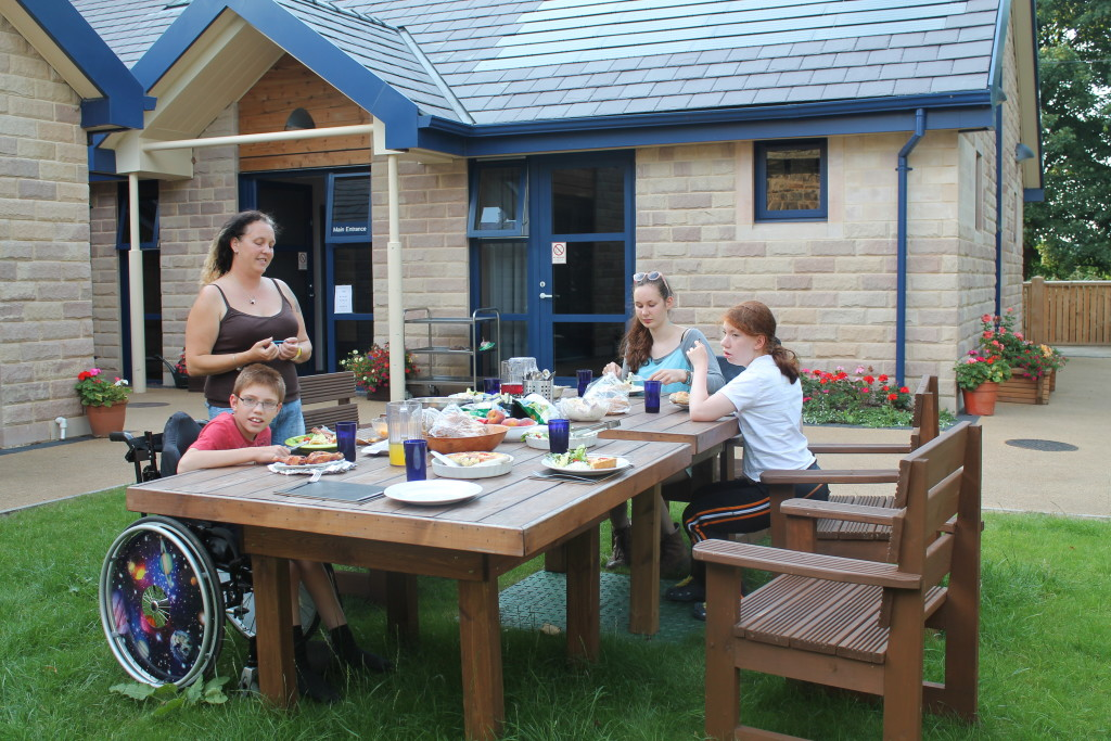 Photo of accessible lodge and visitors