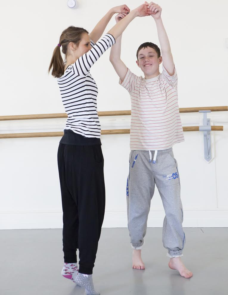 Young boy and girl dancing photo
