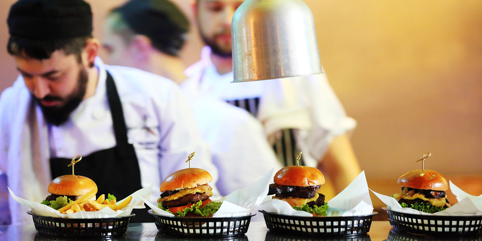 Burgers on display in a busy kitchen