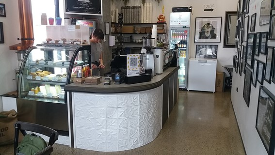 black and white coffee cartel counter