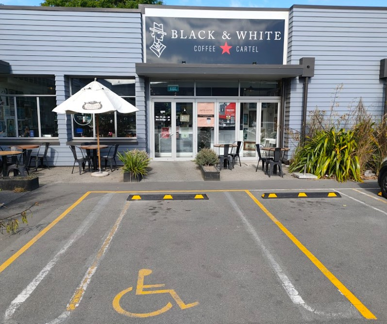 accessible parking at black and white coffee cartel bush inn