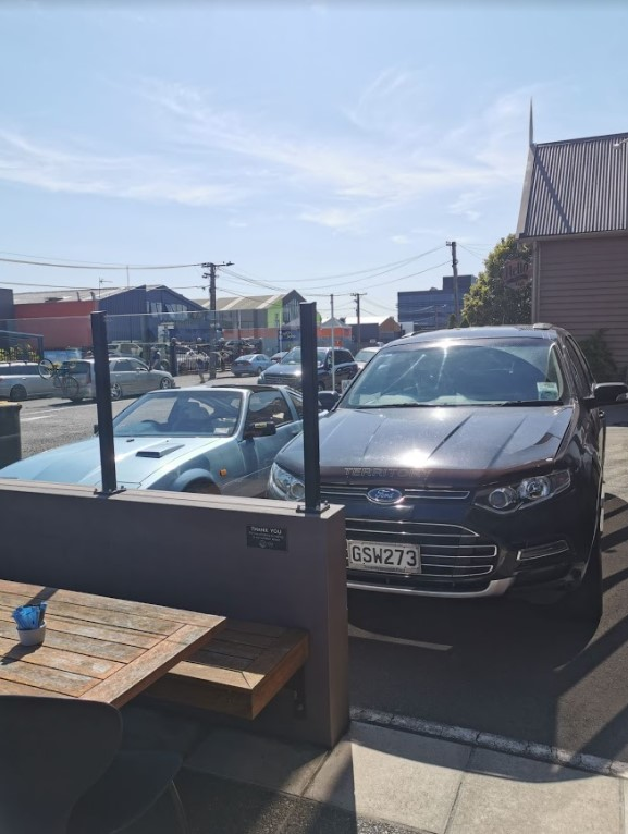accessible parking outside cafe