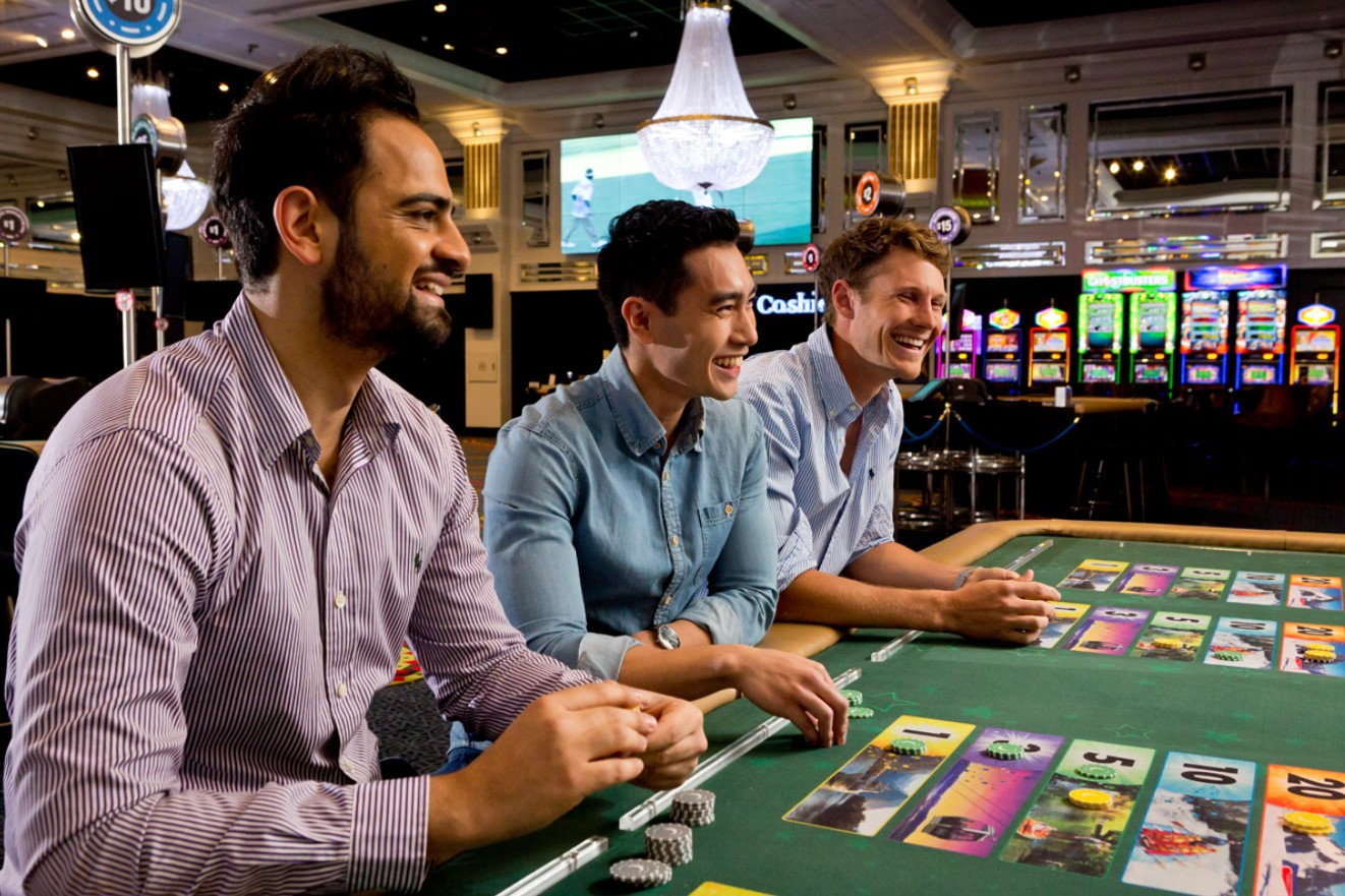 3 men at casino table with chips