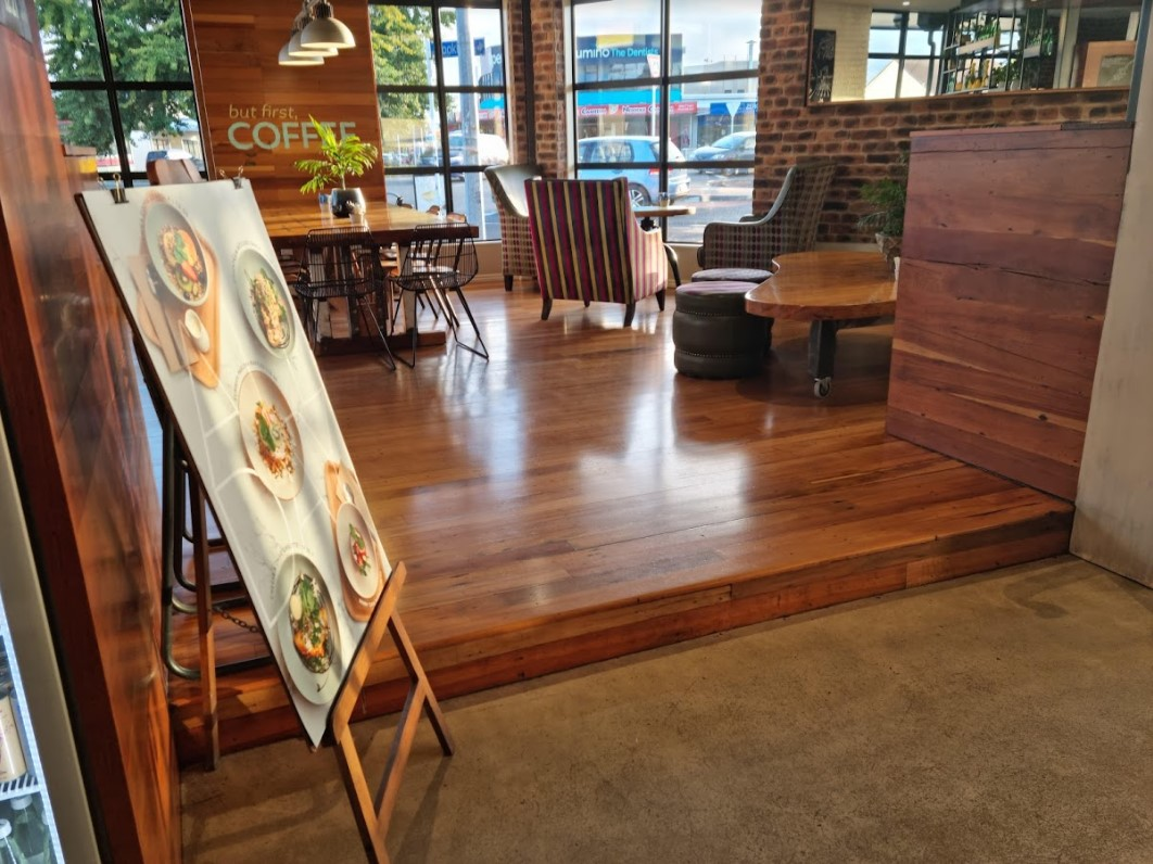 wooden seating area and food board