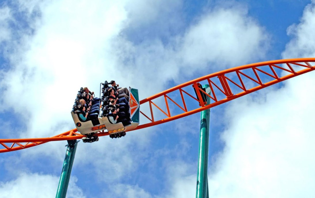 people on overhead red rollercoaster